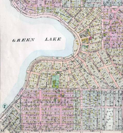 Most of the east shore in a detail from the 1908 Baist Resl Estate Map. North 62nd Street, with footprints of its homes, appears near the bottom of the detail. The blue-green footprint of Green Lake School at 65th and Sunnyside is found at the northeast corner of N. 65th Street and Sunnyside Avenue.