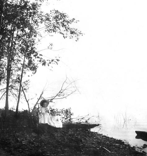 The sisters somewhere on the - most likely east shore of Green Lake near their home and before the lake was lowered in 1911.