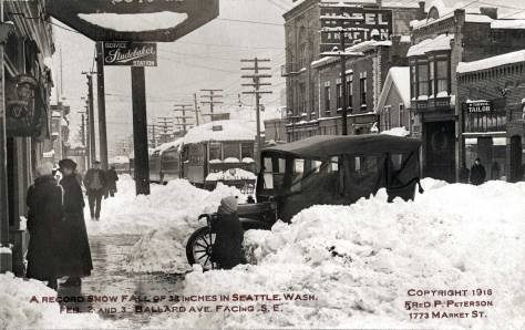 THEN: Ballard photographer Fred Peterson looks south-southeast on Ballard Avenue on February 3rd or 4th, 1916. (Courtesy, Museum of History and Industry)