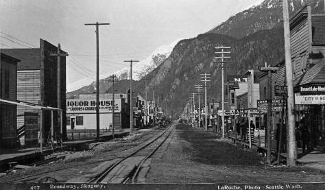 Skagway's Broadway during the warmer cruising months a mad-way of Gold Rush nostalgia and boardwalk kitsch.