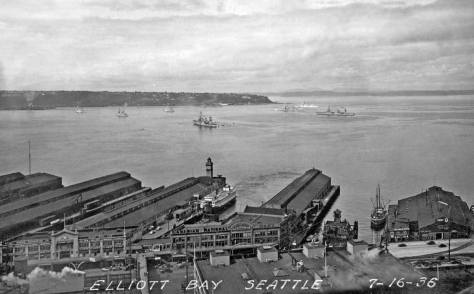 A visit to Elliott Bay by the Navy in 1936. Pier 54 is on the far right, although it was then still number Pier 3. Next to it to the right is the fire station and then the Grand Trunk Pier and Colman Dock.
