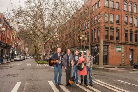 NOW: The Seattle quintet Pineola (pronounced Piney-ola) also poses two blocks south of Pioneer Square at our oldest neighborhood's intersection of First Ave. South and Main Street. L-R: John Owen, Josh Woods, Dirk Lebsack, Leslie Braly, and Ed Brooks. Their second album, Ordinary Things, was released on June 3rd.
