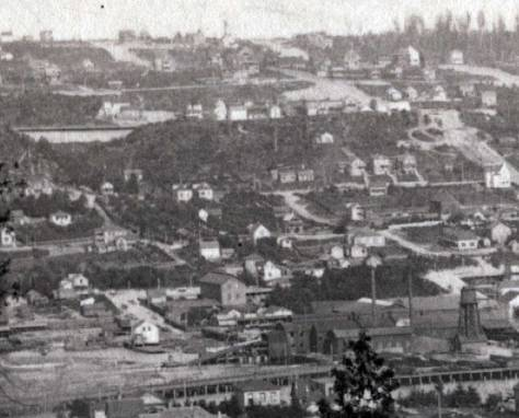 A detail pulled from a mid-1890s McDonald pan, also looking east across the south end of Lake Union and also showing left-of-center the Gothic twins and their not ornamented but bright western facades.