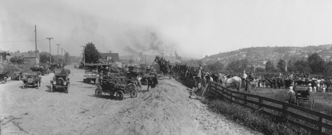 THEN: This panorama could have used a tower (or drone) to better survey the size of the June 1, 191l, crowd gathered in Fremont/Ross to celebrate the beginning of construction on the Lake Washington Ship Canal. (Courtesy, Museum of History & Industry)