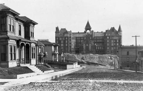 A closer look to the rear of the Denny (AKA Washington) Hotel, this shot early by the NPRR photographer Hayes on visit to Seattle ca. 1890 or 1891. The shot looks south on Third Avenue from north of Virginia Street. (Courtesy, Montana Historical Society)