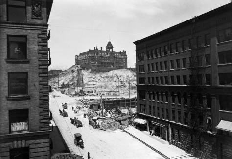 The Washington Hotel, formerly the Denny, recorded from the southwest corner of Pike and Second Ave. The Pine and Second Avenue regrades encroaching on the hotel began their cuttings in 1903. (Courtesy, Washington State Museum, Tacoma)