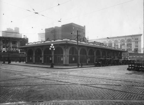 "Another of the first of the ""Triangle Buildings,"" this one looking northwest through the intersection of Pine Street and Fifth Avenue. Frederick and Nelson is just out-of-trams to the right. The Seattle Times building on Westlake between Olive and Stewart is on the far right."