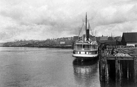 THEN: F. Jay Haynes recorded this ca. 1891 look up the Seattle waterfront and it's railroad trestles most likely for a report to his employer, the Northern Pacific Railroad. (Courtesy, Murray Morgan)