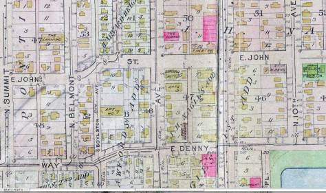 The nearly new Society Theatre's foot print appears at the top (middle-right) in this detail from the 1912 Baist Real Estate map. Note how an early user has drawn in with pencil the future adjustment's on John at Belmont .