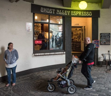"""NOW: In Merceda Yaeger-Carrabba's Ghost Ally Espresso the """"tables are open."""" While the espresso shop dispenses caffeine in many concoctions it treats the entire Market as its confectionary. An exception is gum, which the Ghost espresso sells for citizen application to Post Alley's populist gum wall."""