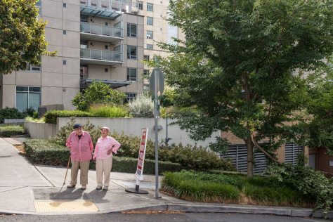 "NOW: Posing here in the pink, Antonette and Robert Ruppin, long-time florists for the Bon Marche department store, are the oldest residents of the First Hill block that was once home for the Sunset Board Room (seen in the ""then"") and the Capri Apartments at the northeast and southeast corners, respectively. The newlyweds left the Capri in the late 1950s but recently returned to the block to take occupancy on the 19th floor of Skyline, the new nonprofit that describes itself as ""Seattle's only Life Care retirement community."""