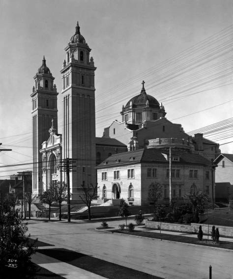 Looking north on 9th Avenue from mid-block between Cherry and Columbia Streets to the Graham/Hausman's bigger neighbor kitty-Korner to the northeast across the Columbia Street and Ninth Avenue intersection. The cathedral was dedicated in 1907.