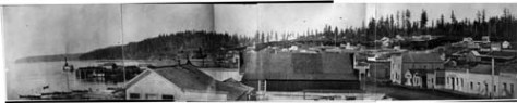 Perhaps or probably the most revealing photograph taken of Pioneer Seattle. The photographer, Robinson, took it 1869 from a second window in Snoqualmie Hall at the southwest corner of Main Street and Commercial Street (First Ave. South).
