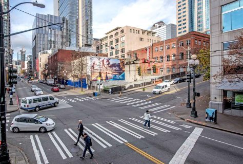 NOW: Only the 126 year-old red brick Hotel Diller, at the southeast corner of First Avenue and University Street, survives in what a 110 ago was a block of seven hotels and one tailor.