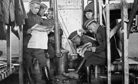 ww1-newspaper-readers-in-barracksweb