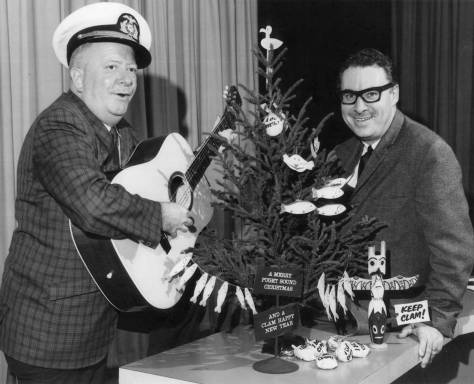 """Ivar playing - and singing - his Christmas contribution, """"The Sixteen Days of Christmas"""" for radio host Don McCune. (see the story below)"""