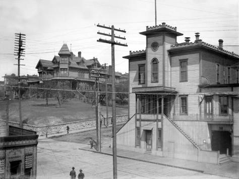 """City Hall, aka the """"Katzenjammer Kastle,"""" at the southeast corner of Third Ave. and Jefferson Street, ca. 1897, with the Yesler Mansion beyond it at the northeast corner."""