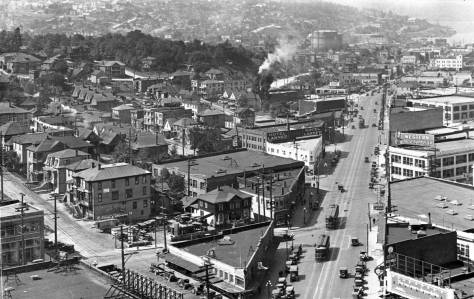 "On the left, the ""Old Quarter"" looking north on Westlake from the Medical-Dental Building. The green acres of Denny Park are at the top, on the north side of Denny Way."