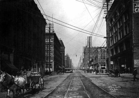 The engineer-photorgrapher and Norwegian immigrant Anders Wilse recorded this look north on Second Avenue from Yesler Way in the mid 1890s. The Butler Hotel appears in the left, left-of-center. It is still at its original height. The Seattle Hotel is submerged in the shadows on the left.