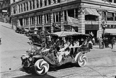A 1911 parade poser at the intersection of Marion Street and Third Avenue. The southeast corner with the nearly new Central Building rises behind it.