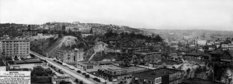 THEN 1: Recorded on April 14, 1928, about sixth months before the Denny Hill Regrade No. 2 began, the last of the scarred Denny Hill rises to the right of Fifth Avenue. Denny School (1884) tops the hill at the northeast corner of Battery Street and Fifth Avenue. On the horizon, at center, Queen Anne Hill is topped by its namesake high school, and on the right of the panorama, the distant Wallingford neighborhood rises from the north shore of Lake Union. (Courtesy, Seattle Municipal Archives)