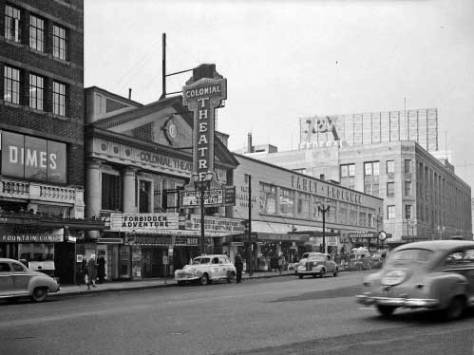 The Colonial Theatre and the Bon Marche at its old height, ca. 1947.