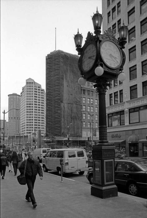 One of the few survivors: the clock on Fourth Avenue south of Pike Street. I remember taken the photo but not when, so I contribute a circa 1999 date.