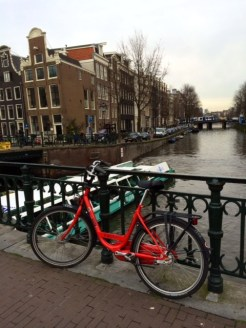 My rental bike, getting a much-needed rest by a canal