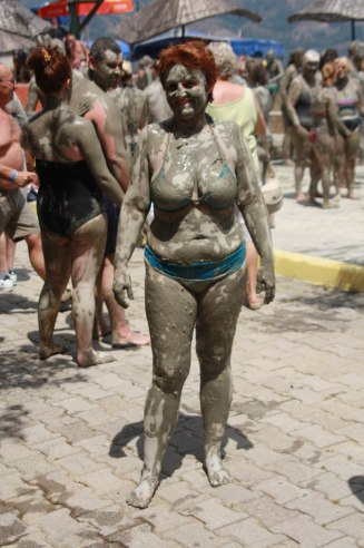 lady at beach covered in mud