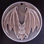 'Bat' carveing in a silver USA 1964 (Kennedy silver half $) 1a