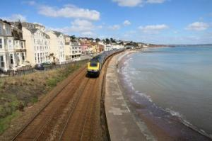The sea-front rail line designed by Brunel provides passengers with spectacular coastal views.