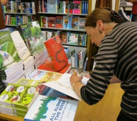 Author's joy...signing books at Stanfords, London.