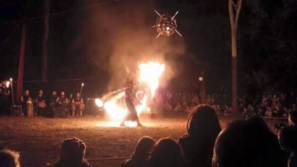 Fire dance using lycopodium flash powder.