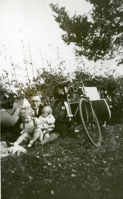 Family outing and an early model of the bicycle  sidecar.