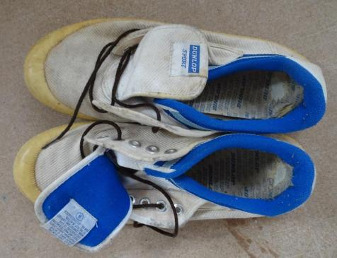 Well loved pair of Dunlop Volleys