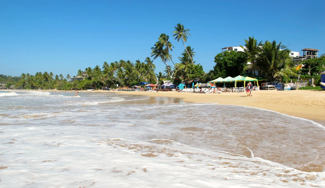 Mirissa beach in Sri Lanka offers incredible ocean views and the sound of waves when falling asleep at night, whale watching, local curry, outstanding yoga and even surfing! Mirissa is for everyone that wants to relax at the beach.
