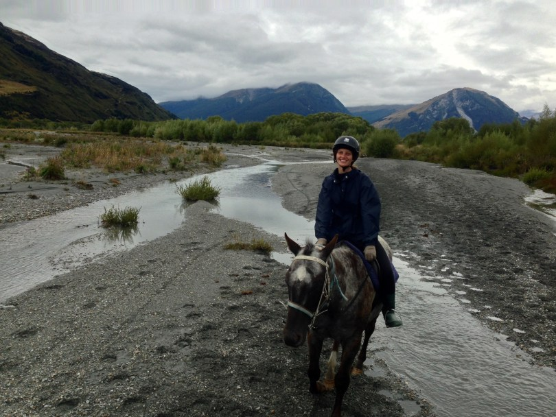 Horseback riding in Queenstown with happy girl