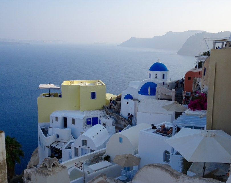 Getting the perfect pictures to send home from Santorini! This is 7 Crucial things to do in Santorini when having 48 hours - Pauline Travels