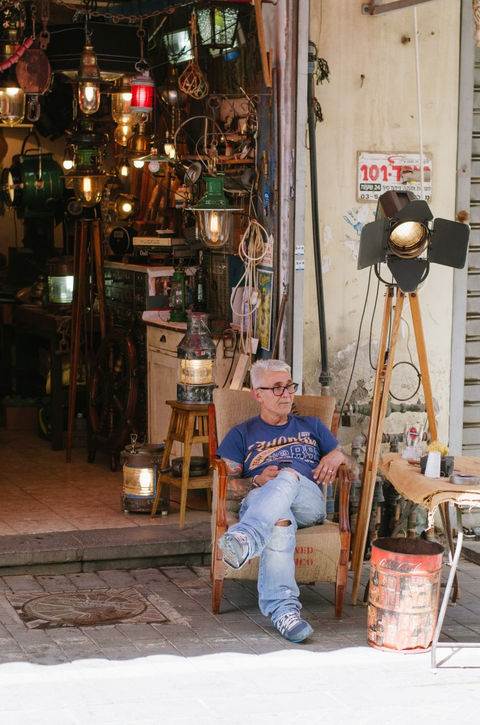 This man sitting outside his store fascinated me. I love his old lights.