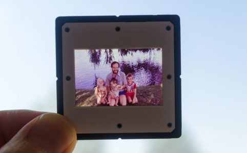 My father, me and my siblings in an old slide photo