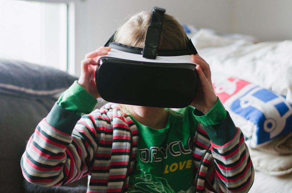 Kids trying on the Gear VR headset