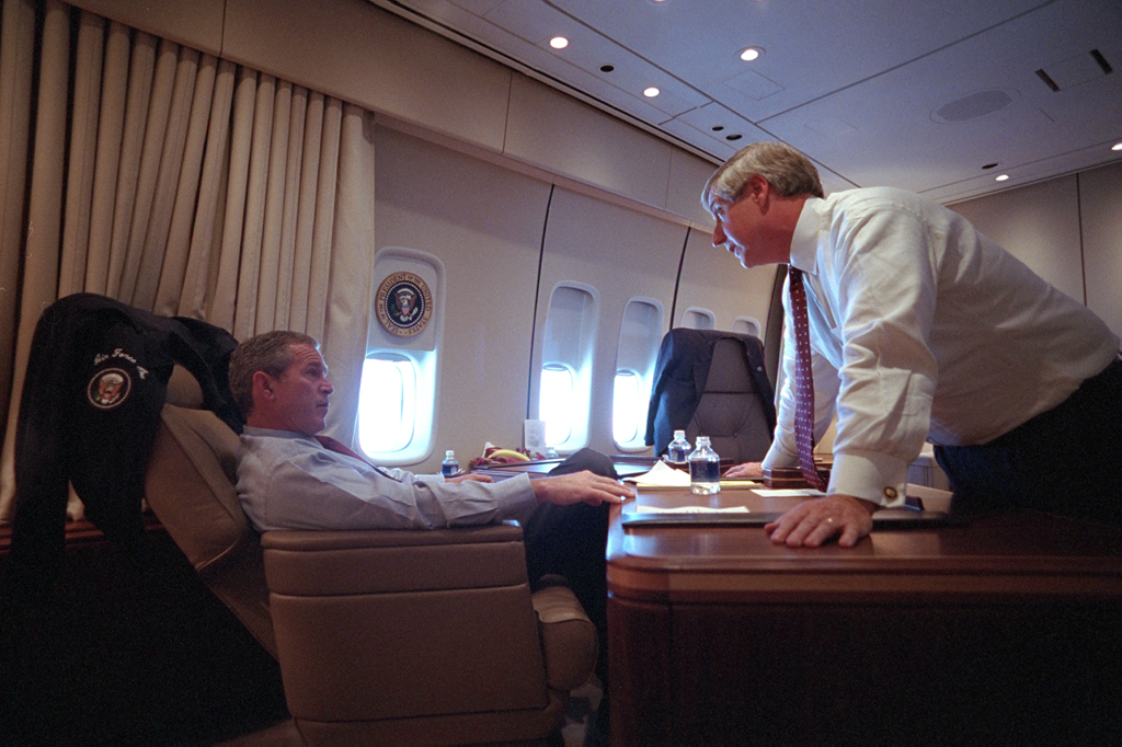 President George W. Bush speaks with White House Chief of Staff Andy Card Tuesday, Sept. 11, 2001, aboard Air Force One.