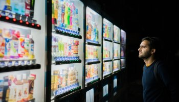 Man looking at vending machines