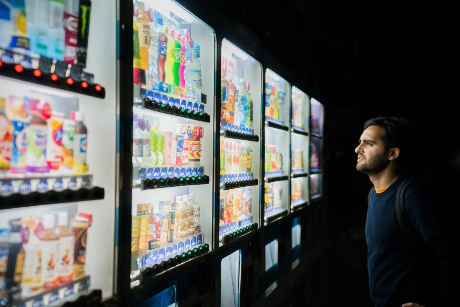 Man looking at vending machines