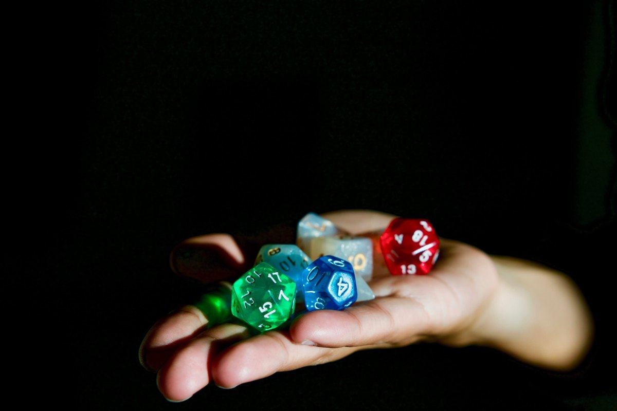 Hand holding Dungeons and Dragons polyhedral dice