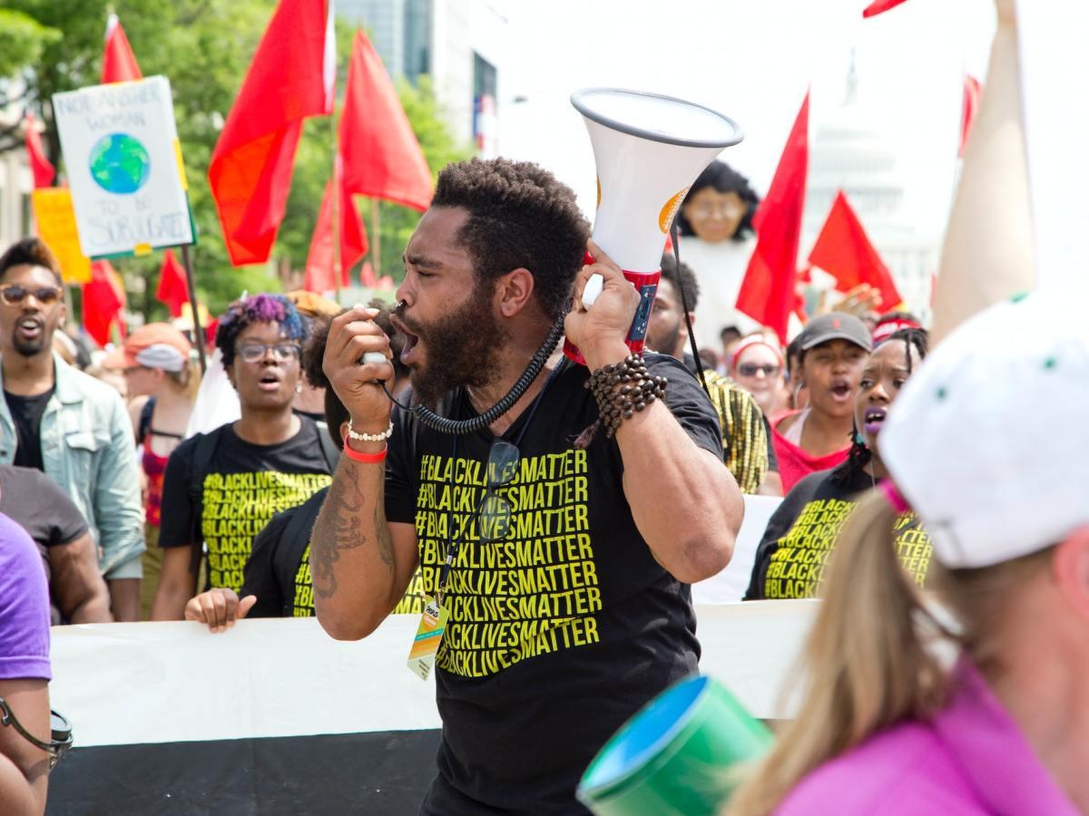 Black Lives Matter protester holding a megaphone