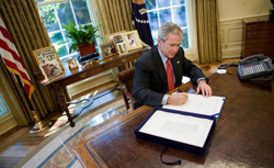 President Bush signs TARP into law.