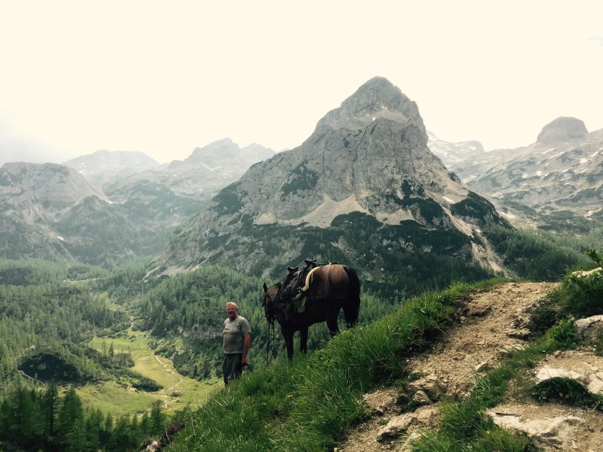 Leading a pack horse down, Triglav National Park, Slovenia