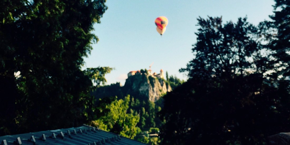 Hot air balloons over Bled castle, Slovenia