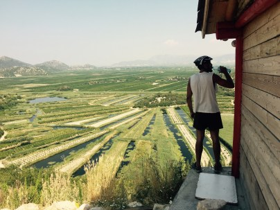 Ervin drinking over the Croatian farm lands